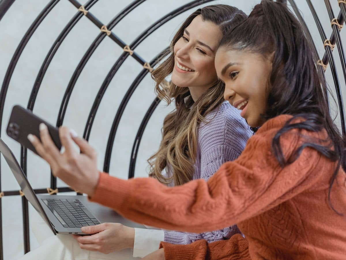 Girls take advantage of a photo op and take a selfie together.